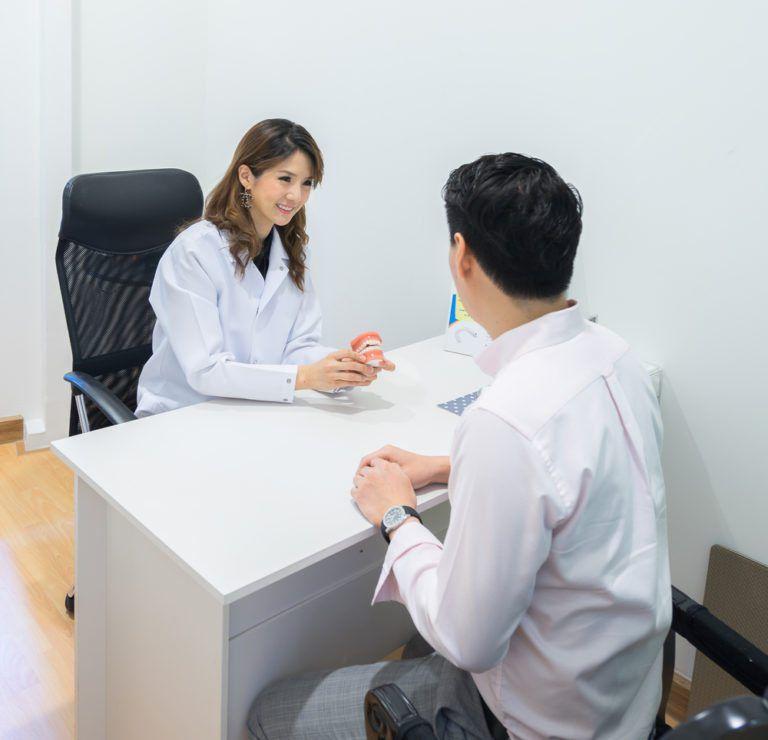 dentist consulting patient